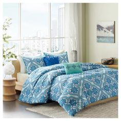 The  Dakota Comforter Set provides a modern take on bohemian chic. Printed on microfiber, this unique pattern features large medallions with intricate design work inside using bold blues and greens. The backdrop enhances this design with its distressed texture featuring lighter hues of the blue and greens from the larger pattern. Two decorative pillows complete this set using fabric manipulation and embroidery details.