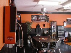 Harley Garage, I installed PVC Diamond Plate Floor Tile Painted walls Black and Orange Decorated in Harley Memorabilia. Harley Pay Phone Professional Poker Table Shelf with Harley Mini Grandfather Clock and so forth. How did I do? , Garages Design