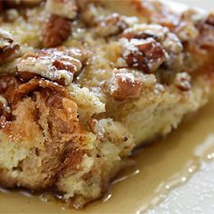 Overnight French Toast Casserole 4 tablespoons (1/2 stick) unsalted butter, melted  3/4 cup firmly packed light brown sugar  1 loaf brioche or challah, sliced 1 1/2 inches thick (about 1 1/2 pounds)  8 large eggs, lightly beaten  1 cup whole milk  1 tablespoon pure vanilla extract  1/2 teaspoon ground cinnamon  1/4 teaspoon ground ginger  Pinch of salt  1/2 cup chopped pecans
