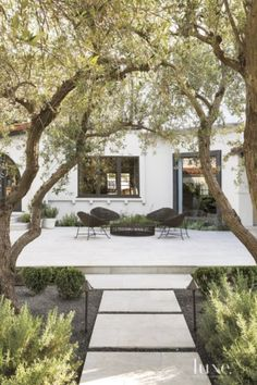 An outdoor living area in the entrance courtyard gives the homeowners a relaxing…