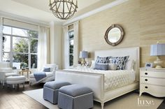 White and blue bedroom.  Neutral beige grasscloth.