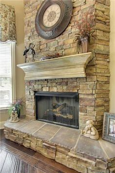 Stack stone fireplace with a distressed mantle. If we ever did a fireplace Rustic Fireplace Decor, Fireplace Redo, Fireplace Remodel, Fireplace Design, Fireplace Mantels, Mantles, Fireplace Ideas, Farmhouse Mantel, Mantel Ideas