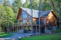 There's no better way to spend a Summer Weekend than in a Timber Block log cabin home. See some of the top cottages constructed in Quebec, Canada.  #timberblock #loghome #logcabinhome #quebechomes #homebuilders #homebuilding #engineered #sustainbleliving #panelized #lakelife