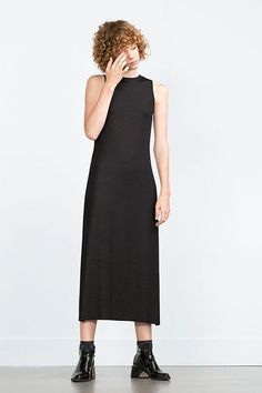 This minimal number is modest in all of the right places. #refinery29 http://www.refinery29.com/little-black-dresses-under-100#slide-10