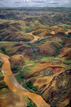 Deforested hills and silt-laden river (aerial), Central Madagascar by Frans…
