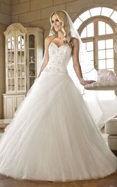 Fairy tale wedding dress features a beaded sweetheart neckline and bodice and a slimming drop waist. Exclusive designer fairy wedding dress by Stella York.