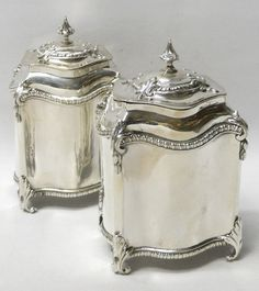 Pair of Antique George III Silver Tea Caddies // An elegant pair of antique sterling silver tea boxes of plain serpentine form having gadroon borders and cast leaf scroll feet and ornaments. With domed pull off lids. Weight 661 grams, 21.2 troy ounces. London 1770. Maker Samuel Wood (known for his sugar casters). Country of origin England Started working 1733 Stopped working Circa 1775 - Price GBP 3,350.00 // - Maria Elena Garcia - ► www.pinterest.com/megardel/ ◀︎