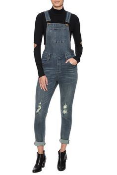 """Slim fitting distressed denim overall. Topped with an apron-front chest with a pouch pocket and adjustable V-back straps that buckle at the front.    Approx.Measures: 25"""" inseam.   Distressed Overalls by Babel Fair. Clothing - Jumpsuits & Rompers - Jumpsuits Nolita, Manhattan, New York City"""