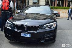 BMW M235i in Sapphire Black & Estoril Blue - As seen on the road - http://www.bmwblog.com/2014/04/26/bmw-m235i-sapphire-black-estoril-blue-seen-road/