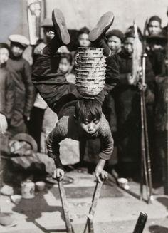 A boy juggler, Kashing, Chekiang Province, China; captured by L. W. Chamberlain (1929)