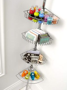 Tuck a tiered shower caddy originally designed to hold bath supplies in a corner of your scrapbook room to make the most of a small space. The baskets can hold any number of scrapbook supplies, including paints, ink pads, stamps, and punches. Craft Room Storage, Craft Organization, Craft Rooms, Storage Ideas, Corner Storage, Corner Shelf, Organization Station, Corner Unit, Bedroom Organization