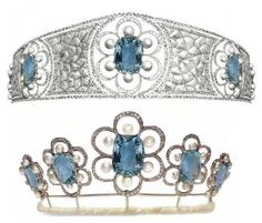 Kent Aquamarine Tiara Designed & created 1908 by Georges Fouquet. Original tiara in form of translucent enamel a jour bandeau incorporating 5 ovals. In center was flower motif consisting of single large Siberian aquamarine, aquamarine surrounded by 6 natural pearls. (top). After 1910 redesigned & new version is w/out bandeau. ovals removed but flower-setting remain: now arranged in openwork surrounds. Unknown if belonged to the Kents or on loan. Not seen in long time.