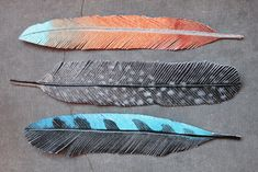 "Paper feathers from Geninne's Art blog ... ""I painted the feathers on watercolor paper and used my super sharp Fiskars scissors to cut the barbs"""
