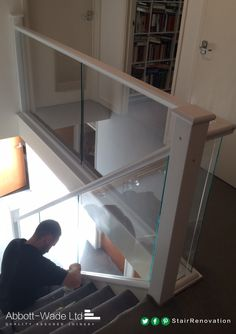Our fitter puts the finishing touches to this white staircase before he can give it the Abbott-Wade seal of approval.