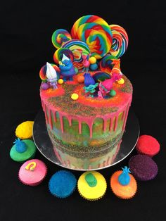 Drip cake - Trolls cake and matching cupcakes, with lollipops, edible glitter and figurines of Poppy, Branch and troll friends!