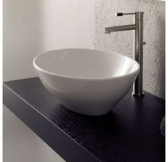 Shop Nameeks Scarabeo Ovo Oval-Shaped White Ceramic Vessel Sink at Lowe's Canada. Find our selection of bathroom sinks at the lowest price guaranteed with price match. Above Counter Bathroom Sink, Bathroom Sink Drain, Wall Mounted Bathroom Sinks, Undermount Bathroom Sink, Bathroom Plumbing, Faucet, Bathroom Vanities, Kitchen Sink, Teen Bathrooms