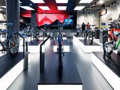 Rose Biketown Store by Blocher Blocher Partners at MONA Mall, Munich - Germany Kayaks, Visual Merchandising, Bicycle Store, Showroom Design, Retail Store Design, Retail Interior, Branding, Light Installation, Design Furniture
