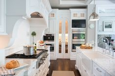 I love the height in this kitchen. Plus the curves on the wood work is beautiful