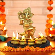 TIED RIBBONS Lord Ganesha Statue with Matki Candle and Wooden Tray cm X 19 cm, Golden) - Diwali Decoration Item for Home - Diwali Gifts for Family and Friends Corporate Diwali Gifts for Employees