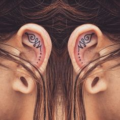 Unalome ear tattoos by Andrea Revenant