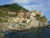 manarola - best places in the world to visit - one of the cinque terre living on the mediterranean cliffs