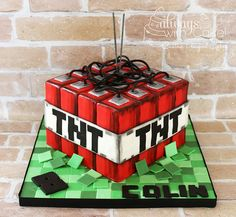 """Minecraft TNT Cake - Covered in one piece of red fondant. Hand painted """"blocks"""" and TNT panel is dusted, to make it look pixelated. Wires are licorice ropes. Mobs Minecraft, Craft Minecraft, Minecraft Cake, Minecraft Creations, Minecraft Ideas, Minecraft Buildings, Minecraft Funny, Minecraft Blueprints, Minecraft Skins"""