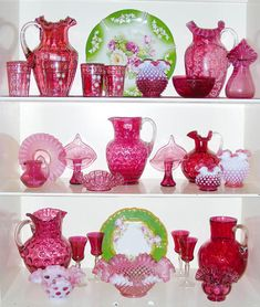 A cabinet full of cranberry glass!