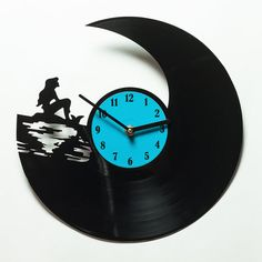 Hey, I found this really awesome Etsy listing at https://www.etsy.com/listing/239661577/mermaid-clock-gift-for-child-vinyl-clock