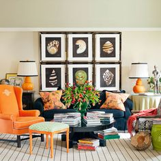 Want to decorate with artwork but don't know how? Hang similar pieces in a grid format to give the illusion of a bigger piece of artwork to draw the eye.
