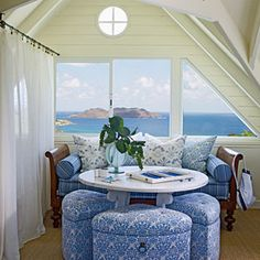 Loft on St. Barts Island Cottage - The third-floor mezzanine functions as a play area for the grandchildren and a place for naps or card games. Sheer curtains create the illusion of enclosure but allow light to flow between the second and third floors. Barry designed the upholstered wedges to be seats for the card table or, when pushed together, an ottoman.
