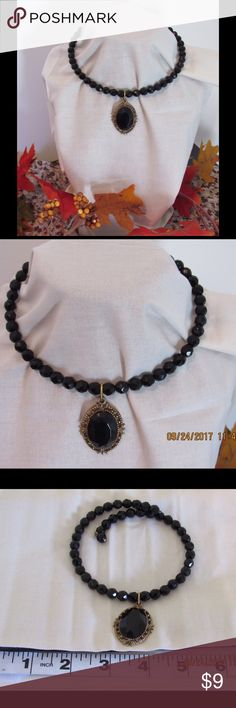 Fashion Choker Necklace Faceted black beads over wire Choker.  Simply wrap around your neck for a quick accessory to business or casual outfit. Contains and ova medallion in the front.  Medallion is faceted black center stone inlayed in a gold tone setting. This piece will enhance any outfit. Other