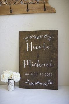 Dark stained custom plywood sign with names, date, and floral design. Can be used for the engagement party, bridal shower, ceremony, and reception.  Hand painted wedding and event signage.