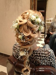 Luscious curls with roses for a bridal