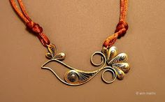Quilled Paper Pendant Jewelry Tutorial - The Beading Gem's Journal  She also has other great quilling ideas and tutorials.