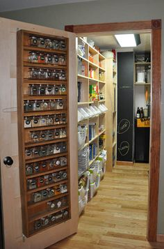 Use a Pantry Door  A pantry door is a great way to store spices or cans because it can hold a wide variety of items while being easily accessible.  Learn more about using a pantry door by visiting The Perfect Pantry.