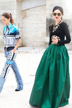 A floor-sweeping emerald skirt commands attention #streetstyle