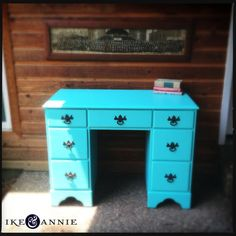 this is the desk I have! I just need to paint it... this blue is a bit too bright. Paint and new knobs and I'm set! WOO
