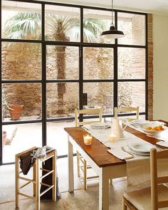 Roll up doors in the kitchen. Another beauty from Spain! This 14th century farmhouse is located in the centre of Madremanya in the Girona region (Spain). The farmhouse has been completely restored.