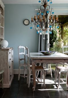 Light blue walls and love the blue and glass crystal chandelier..