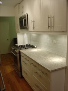 River White Granite, IKEA Adel cabinets, red oak floors
