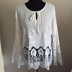 100% Cotton Crochet Bell Sleeve Top Soft ivory cream color. 100% cotton fabric is cool to the touch. Embroidered design. Crochet hemline and bell sleeves. Ties at front collar center point.   Brand new with attached retailer tag. Brand new in package w/o tags. No trades, no holding, no offline/App transactions.      PRICE IS FIRM UNLESS BUNDLED                  5% off bundles  Tops