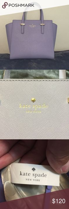 ON HOLD Kate Spade Lavender Purse Authentic Kate Spade Purse.  Inside has a zipper pocket and 2 small slide pockets.  Shoulder strap is missing.  No Dust bag.  Gently used in near perfect condition. No visible scratches or marks. kate spade Bags