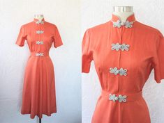 {1940s Vintage Dress} {Peachy Orange Linen} {Light Gray Trim and Frog Closures} {Mandarin Collar} {Short Sleeves} {Fitted Waist w/ Swing-y Skirt} {Matching Original Belt} {Side Metal Zipper} {Unlined} {Labeled Tanya Honolulu} Measurements Estimated Extra Small* Bust - 36 in.