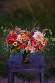 A bridal bouquet full of colorful autumn dahlias in coral, pink, yellow, cream, and peach. Dahlia Wedding Bouquets, Dahlia Bouquet, Bridal Bouquet Fall, Dahlia Flower, Floral Bouquets, Wedding Flowers, Coral Bridal Bouquets, Cactus Flower, Rare Flowers
