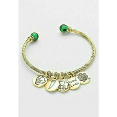 """Gold lucky clover charm open cable cuff bracelet Pretty gold tone cable cuff bracelet dazzled with mini gold tone with lucky charms and green gemstone tips. Fits wrist 7 to 7.5"""" perfectly. Great quality and design. Brand new with tag. Jill Marie Boutique Jewelry Bracelets"""