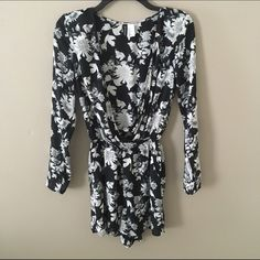 Flowered Romper H&M Black and white flowered romper. Long sleeve and deep V, shorts. Small button to close V.  Perfect with boots! Worn once! Divided Other