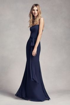 This long fit n' flare gown is perfect for a special night full of elegance!  Long fit n' flare gown featuring crinkle chiffon with spaghetti straps and figure flattering skirt godets.  A trendy self-tying sash to tie up your look.  Fully lined. Back Zipper. Polyester. Dry clean.