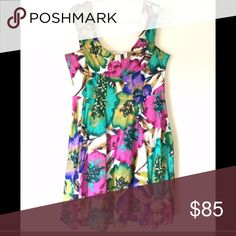 Calvin Klein Bright Floral Dress. Sz 12 This was bought retail and you can't find a dress like this now! Beautiful floral detail on this plunging neckline dress. Great for spring or summer weddings or dates. Worn twice and in excellent condition. Sz 12. Offers welcomed. Calvin Klein Dresses