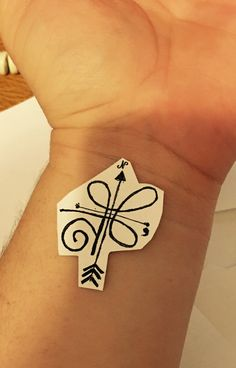 The Celtic design is a symbol for strength and the arrows from the compass that always guide you to go ahead and keep going && then the semi colon is for depression, anxiety, or even bullies.
