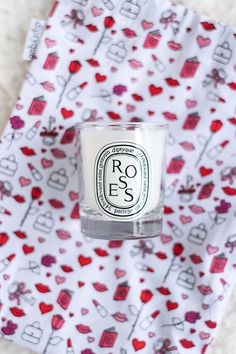 Over the weekend I was walking in Soho with my friend Alexis when the window display at Diptyque caught my eye. It was covered in whimsical illustrated lips, bags, hearts, and books in vivid shades of pink and red…so of course I had to check it out. Inside I found ...